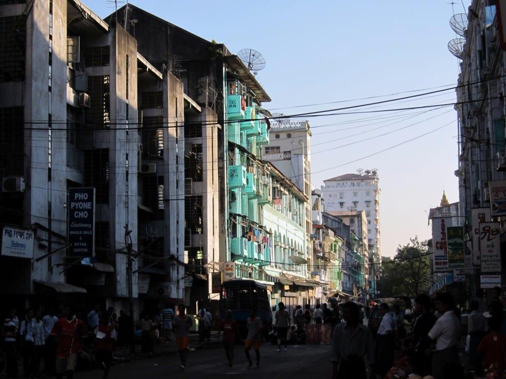 Light shining on the colourful buildings of Yangon Burma Myanmar