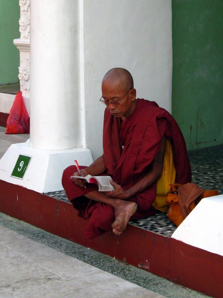 Monk reading at Shwedagon Pagoda Yangon