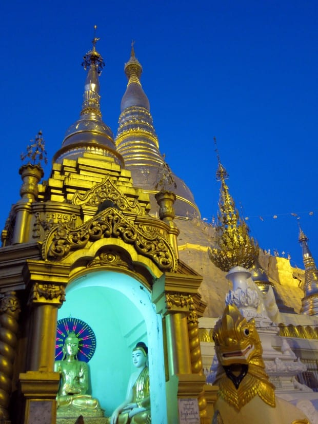 Buddha at dusk in Shwedagon Pagoda in Yangon, Myanmar