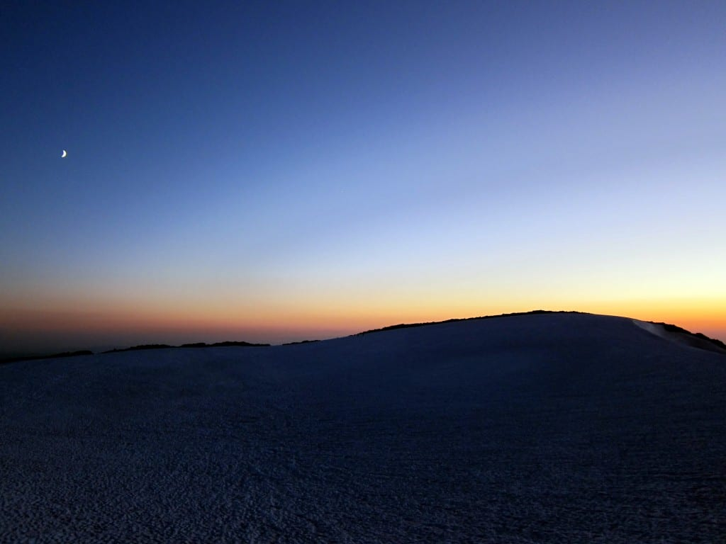 Moon rising over the summit of South Sister mountain in Oregon