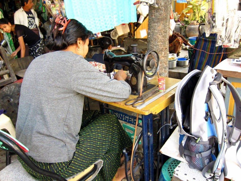 Shortening the hem of my longyi in Mandalay