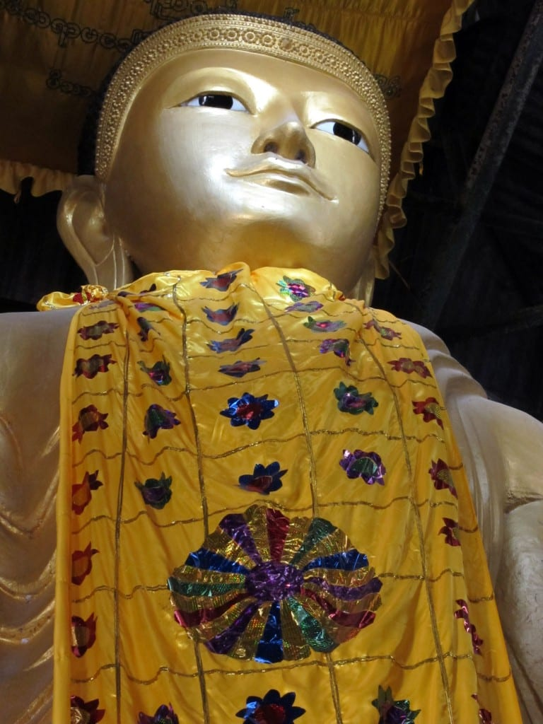 A good way up Mandalay Hill, a beautiful standing Buddha gilded in gold.