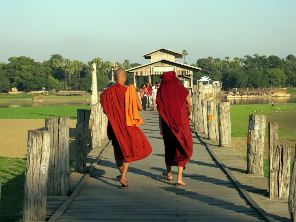 Monks walking across U Bein Bridge