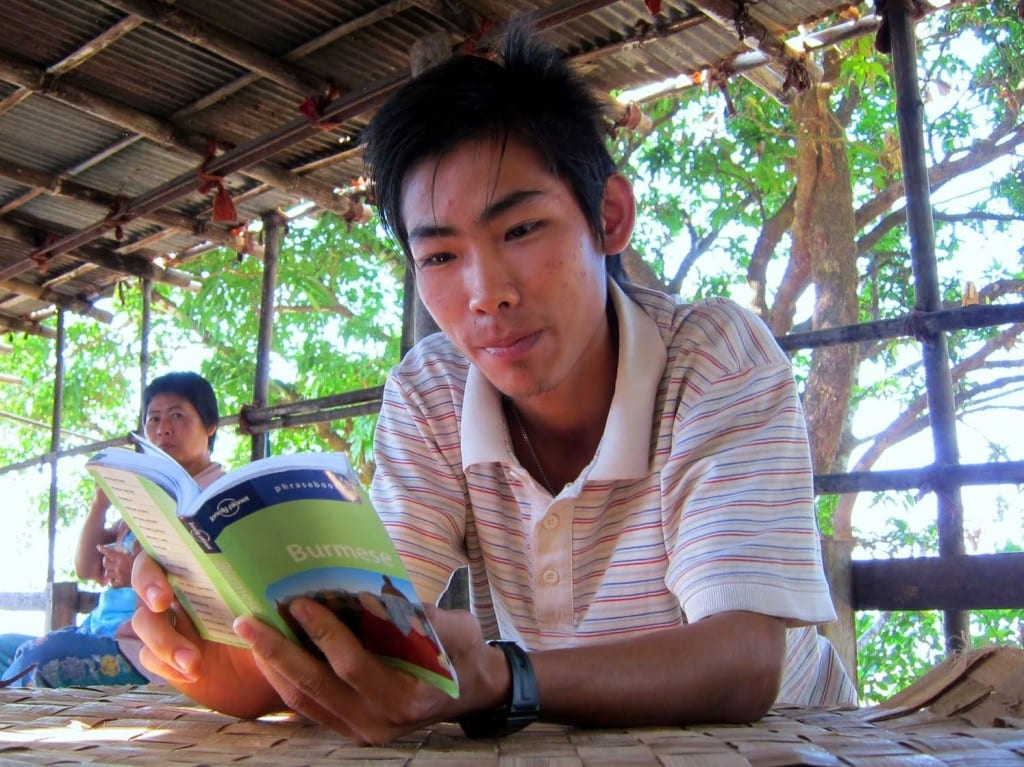 Burmese boy reading LP's Burma Language Guide