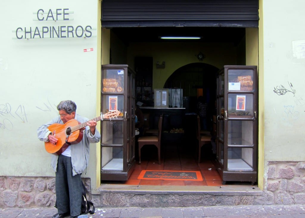A man plays guitar for change in Quito's Old City.
