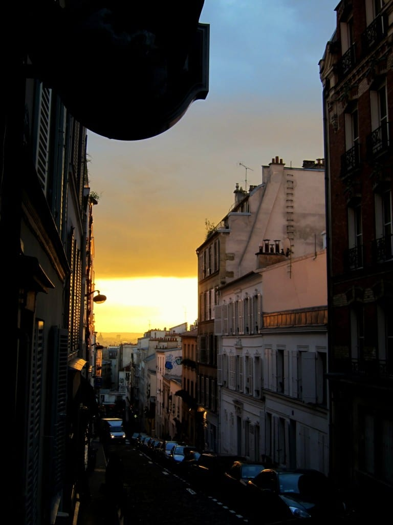 Midway up toward Sacre Coeur, with Paris in the afternoon glow below.