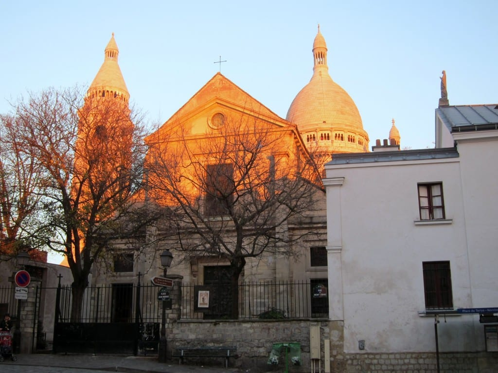 Sacre Coeur lit up by the afternoon sun in Paris