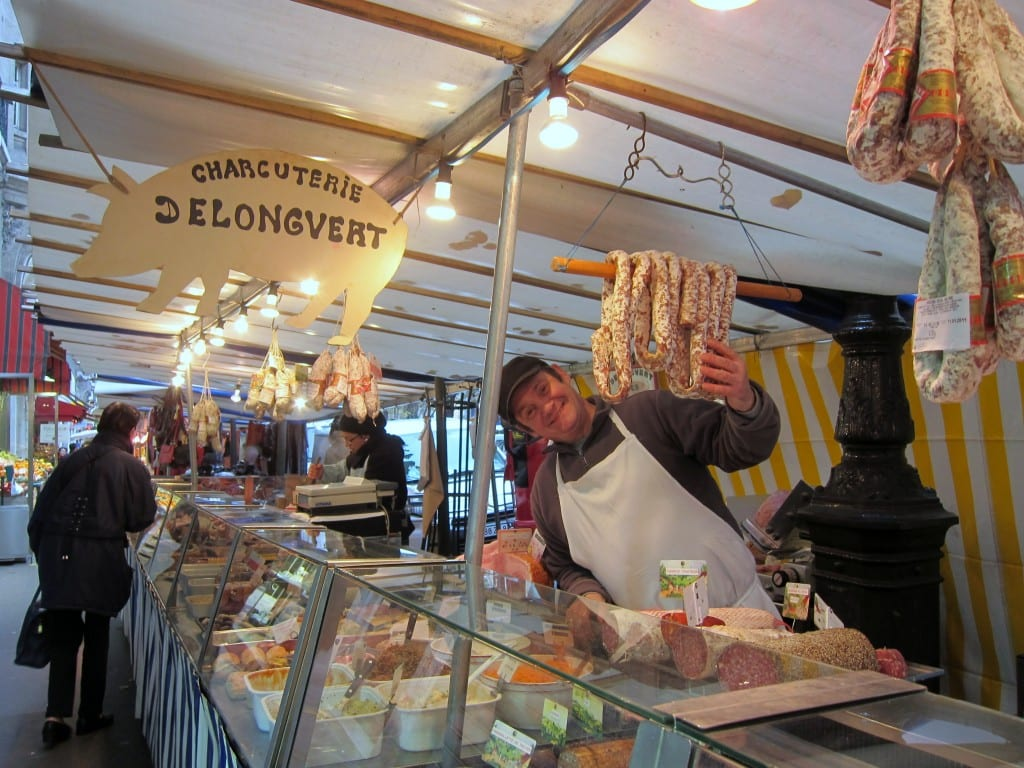 The friendly butcher in Paris' Convention market.