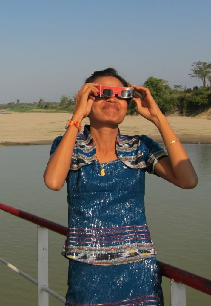 Burmese woman watching the solar eclipse