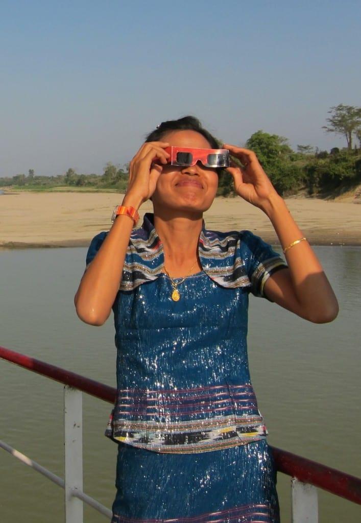 Burmese woman watching the solar eclipse