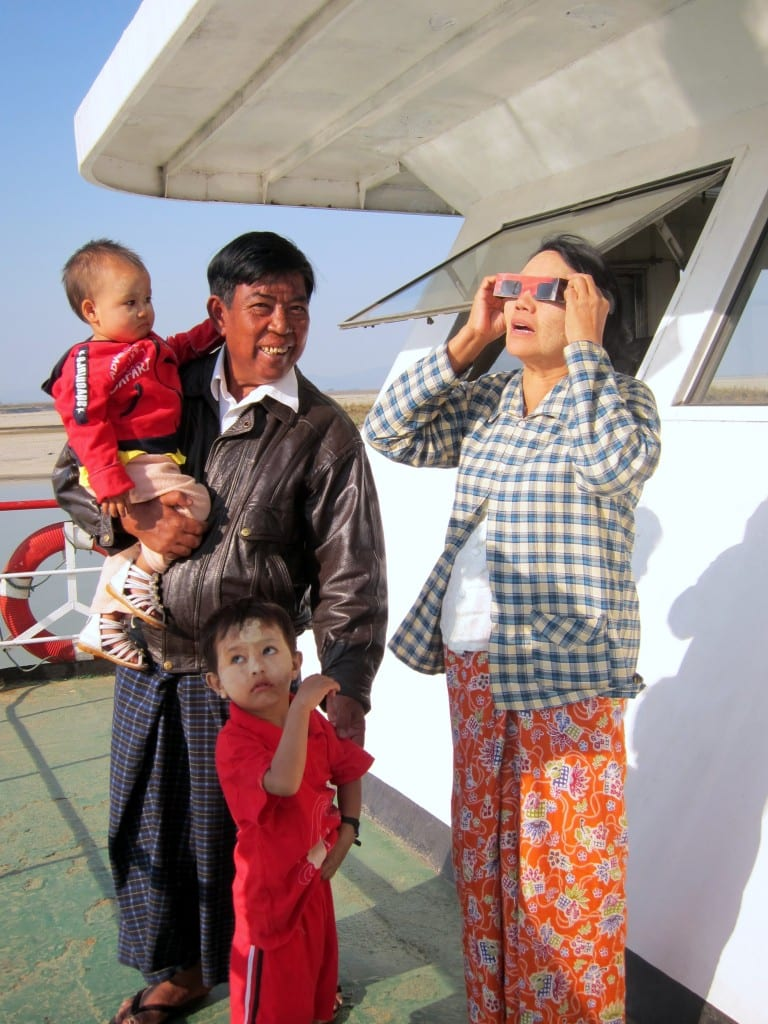 Burmese family watching the solar eclipse