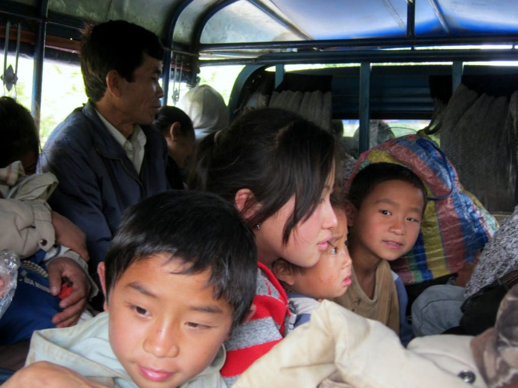 Ok, now it's getting crowded on this chicken bus in Laos