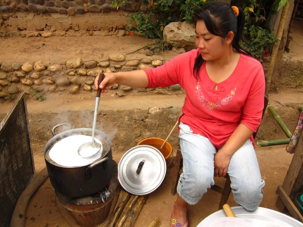 Making steamed spring rolls in Muang Ngoi