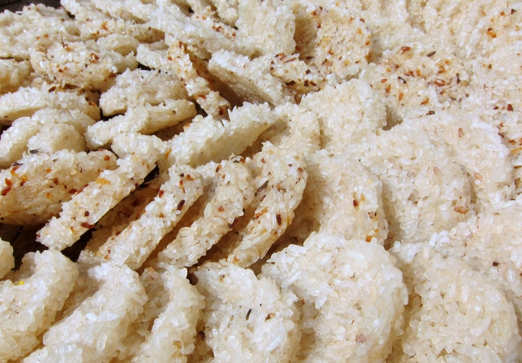 Rice cakes drying in the hot afternoon sun in Laos