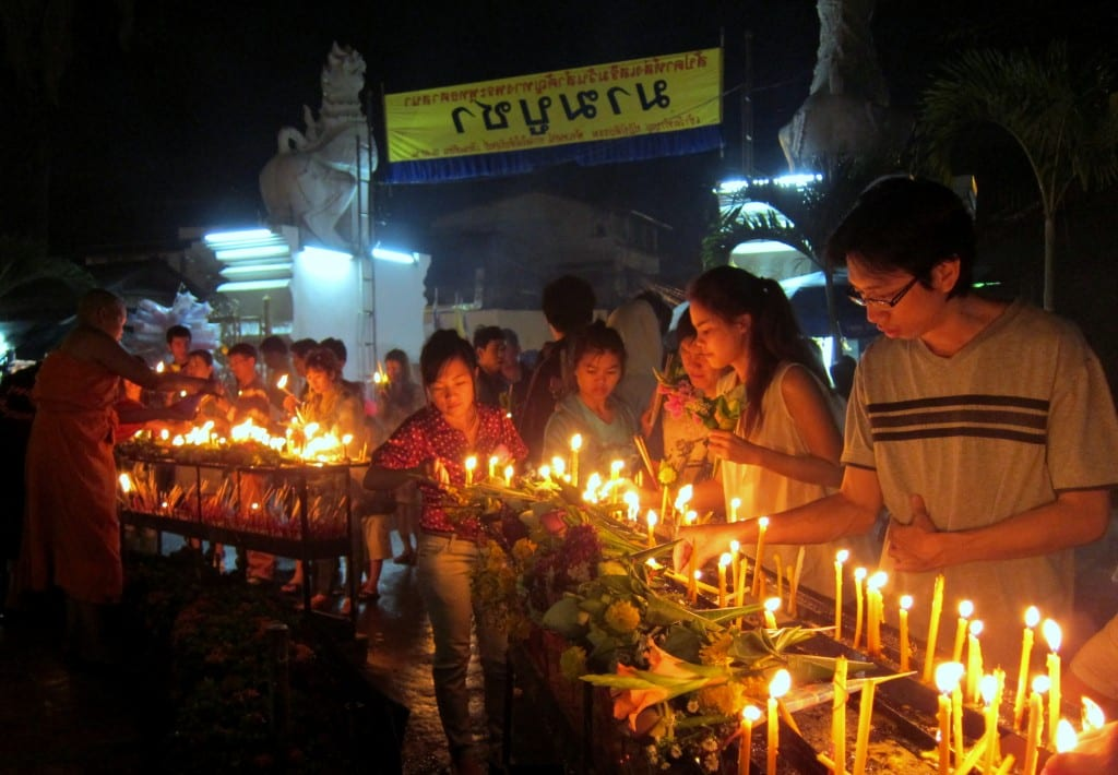 Lighting candles on Makha Bucha Day in Chiang Mai