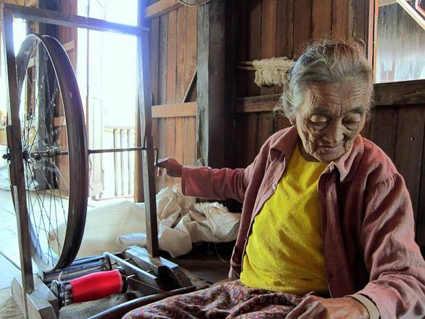 Inle Lake Burma- woman weaving silk from lotus seeds