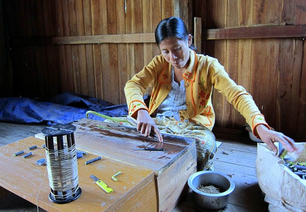 Inle Lake Burma- woman weaving silk from lotus seeds