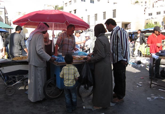Sweets for sale on the sidewalk in Amman