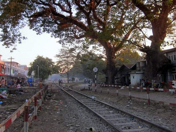 Misty, sun-spotted train tracks in downtown Myitkyina, Burma