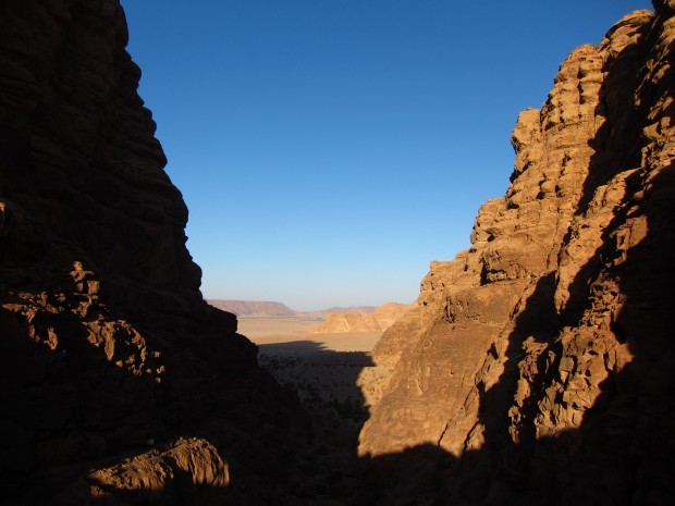Peering at the water and valley below, in Wadi Rum