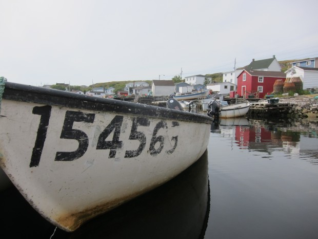 Boats reflecting off the still water in Greenspond, Newfoundland