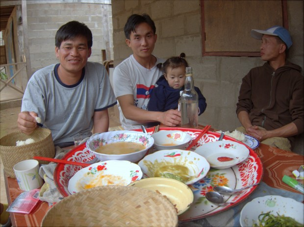 Eating dinner with the village chief in Northern Laos
