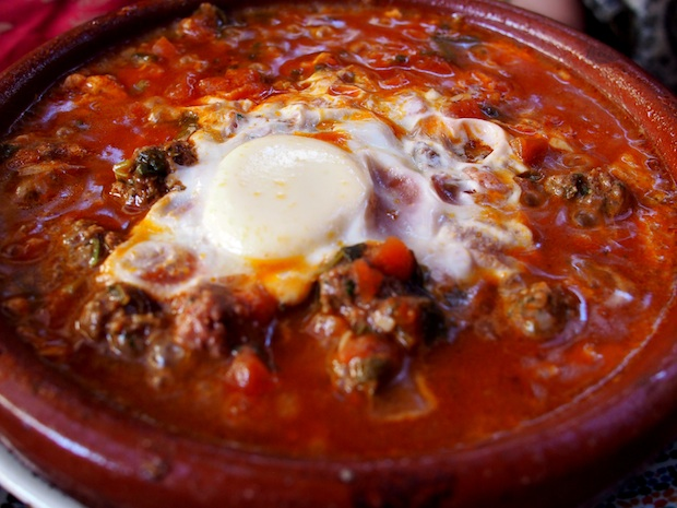 Beef kefta tagine with tomato, onion and egg in Essaouira