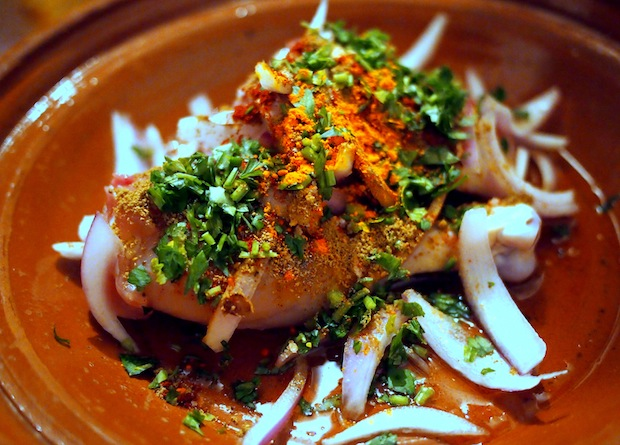 How to make tagine: piling in the chicken, onions and spices