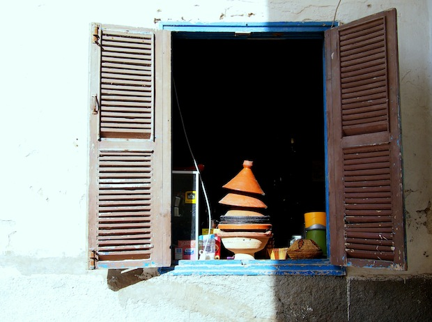 Taginieres piled in a window in Essouira